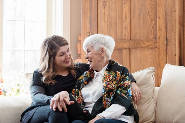 Senior mother visiting with daughter and talking about retirement